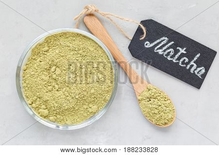 Composition with matcha green tea powder and chalk board top view horizontal