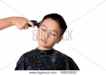 Young Asian Boy Hair Cutting