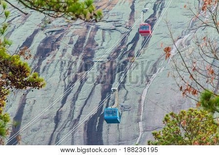 Two cabins of the cableway in the Stone Mountain Park on the background of mountainside Georgia USA
