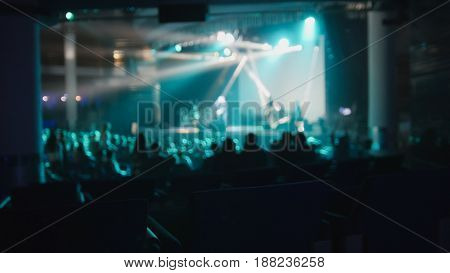 Abstract blurred - a crowd of young people at a rock concert in club