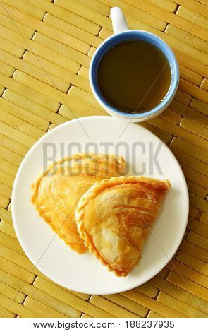 curry puff stuffed chicken and bean eat couple with hot tea