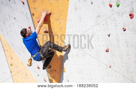 The Man Climbs On The Climbing Wall.