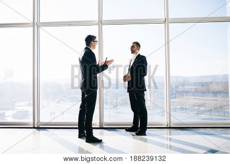 Two Businessmen Dicussing Business Perspectives In Office
