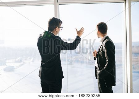 Two Businessmen Dicussing Future Business Plans Of Building And Development In Office