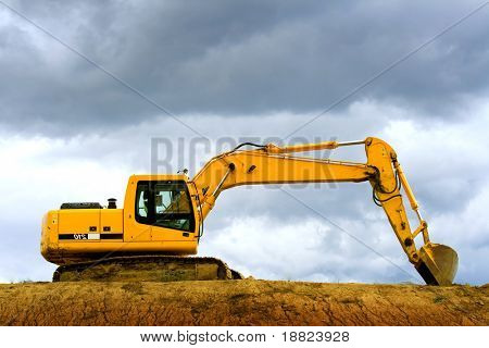 Earth digger on a dramatic cloudy day