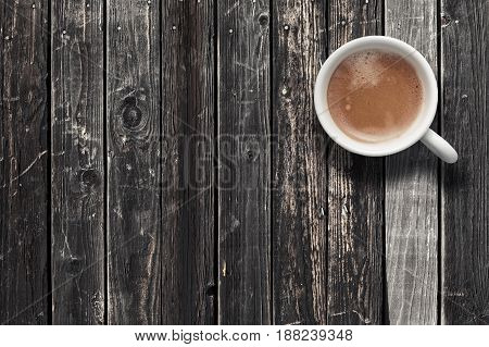 White espresso coffee cup top view on dark wooden table background