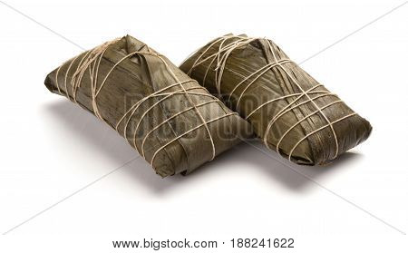 studio shoot of two wrapped Chinese ZongZi on white for Dragon Boat Festival ie DuanWu festival