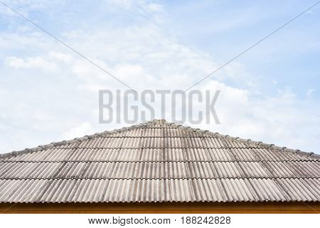 The roof of the house with blue sky