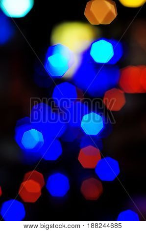 Many colorful heptagon bokeh on night atmosphere.