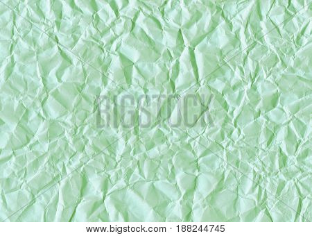 Mint green texture background of crumpled paper