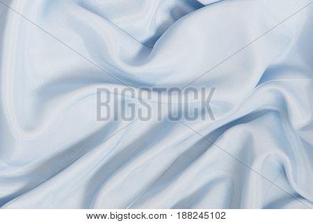 Soft blue silk ore satin wavy background