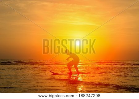 Vacation Concept ; Happy surfer playing with surfboards on the beach at sunsetPhuketThailand
