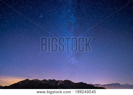 The Wonderful Starry Sky On Christmas Time And The Majestic High Mountain Range Of The Italian Frenc