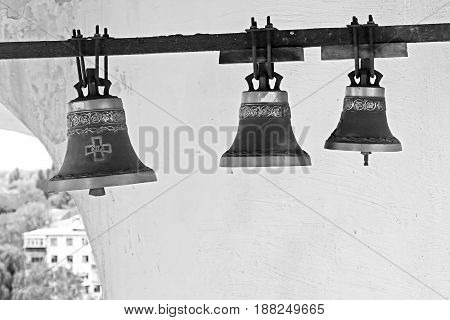 Bells inside bell tower of Trinity Monastery in Chernigiv, Ukraine. Black and white