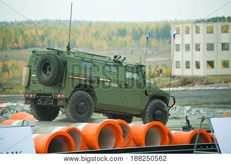 Nizhniy Tagil Russia - September 25. 2013: Russia Arms Expo-2013 exhibition. Tigr-M armored vehicle for Special Forces - AMN 233115 Tigr-M SPN. Display of opportunities of military equipment