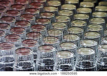 Many different drinking glasses on the table
