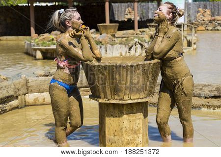 Young girls take mud baths to improve the condition of the skin and strengthen the immune system