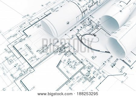 Architectural Background With Blueprint And Rolls Of Technical Drawings