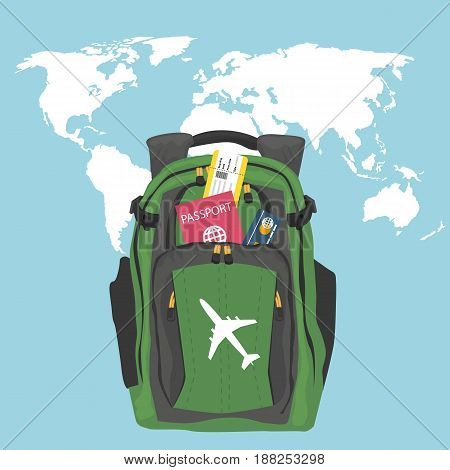 Green backpack with passport, air ticket and credit card over world map