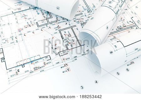 Architectural Project Plan And Rolls Of Blueprints For Home Renovation