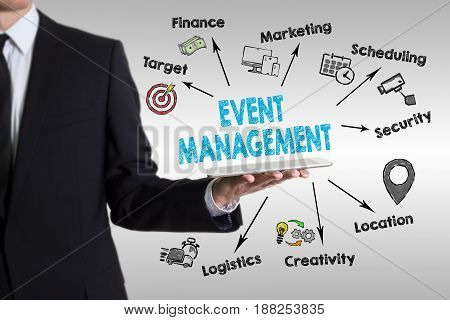 Event management concept with young man holding a tablet computer.