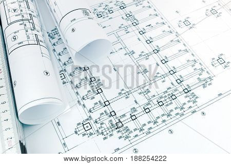 Architectural Graphical Project Plans For House Apartments, Rolled Blueprints And Ruler