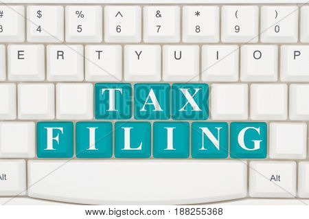 Filing your taxes online A close-up of a keyboard with teal highlighted text Tax Filing 3D Illustration