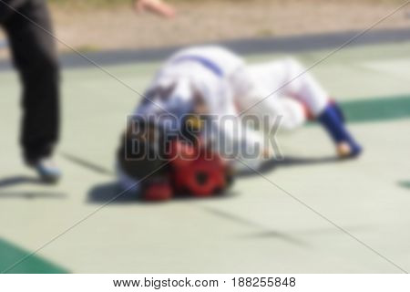 A blurred abstract background can be an illustration to an article about wrestling and sporting events