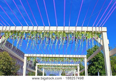 KYIV, UKRAINE - MAY 01, 2017: Easter celebration decoration made of bright ribbons eggs and flowers in front of deep blue sky