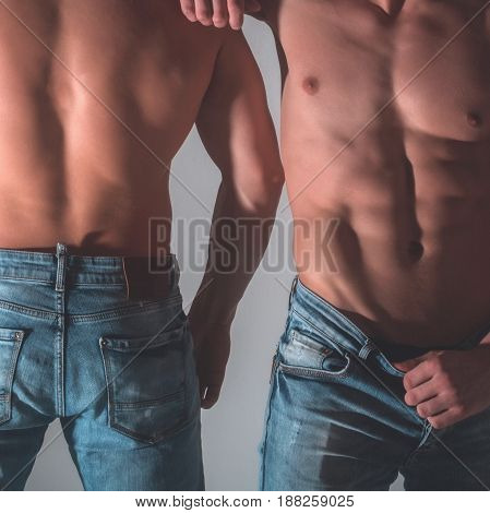 Front And Back Of Two Male Torsos