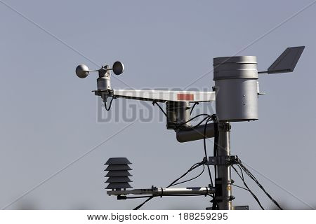 A Weather station close up with a blue sky.