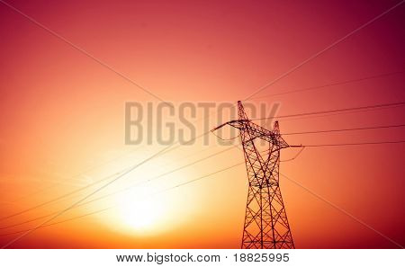 Electric power lines in sunset