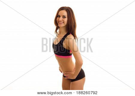 beautiful sexy athletic girl smiling and posing for the camera isolated on white background