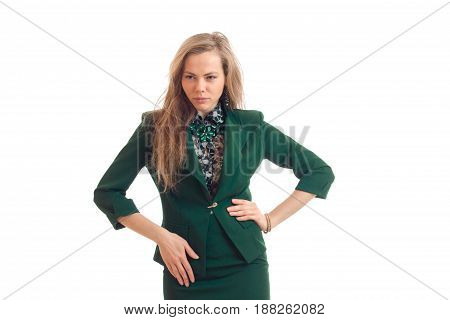 sexy young blonde has his hands on the sides and looks toward isolated on white background