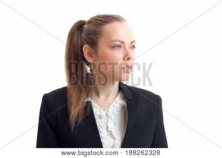young sexy business woman with the ponytail looks toward close-up isolated on white background