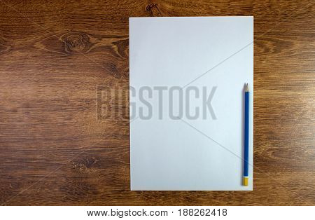 Blank empty notepad and pencil on wood table