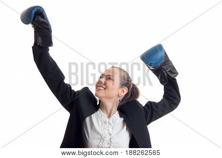 a cheerful young girl raised her hands up in boxing gloves close-up isolated on white background
