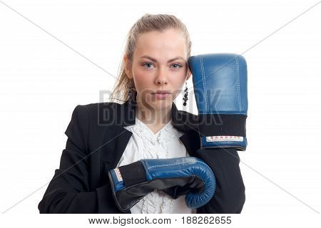 Portrait of serious young blondes in boxing gloves close-up isolated on white background