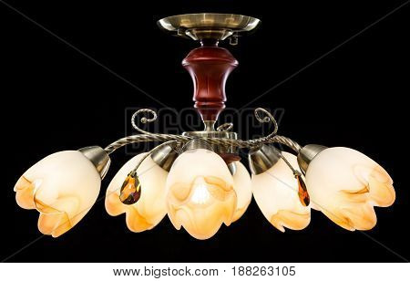 Modern Chandelier for interior decoration of the living room. Bronze Chandelier isolated on black background.