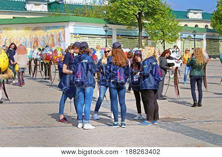 KYIV, UKRAINE - MAY 01, 2017: Eurovision's volunteers on Mikhalovska Square near Eurovision song contest fan zone