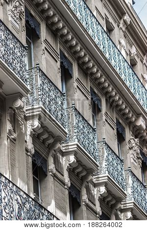 Building details. Ornate facade with forged balconies. Toulouse, France