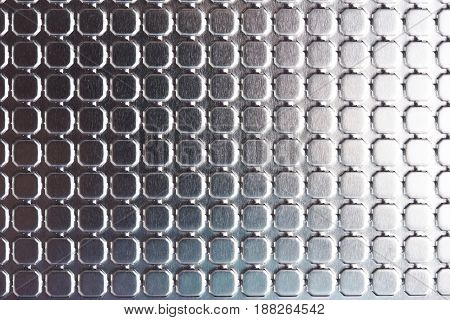 Squares On Shiny Metal Surface