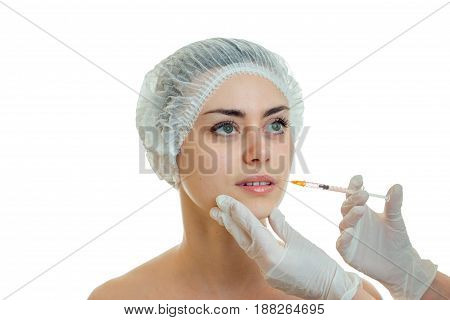 beauty therapist conducts a rejuvenating facial girl close-up isolated on white background