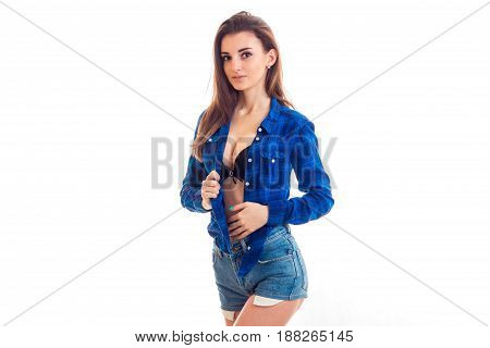 wonderful sexy girl posing on cam in shorts and unbuttoned shirt isolated on white background