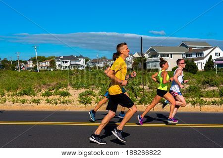 Spring Lake NJ USA -- May 27 2017 Runners race down Ocean Avene in the annual Spring Lake 5 mile Race. Editorial Use Only.