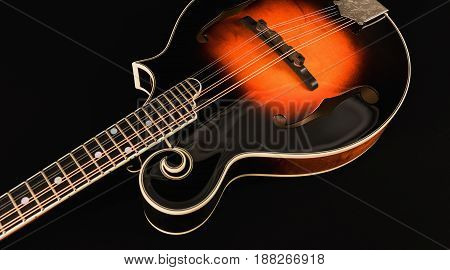 Mandolin with high gloss on a dark background.