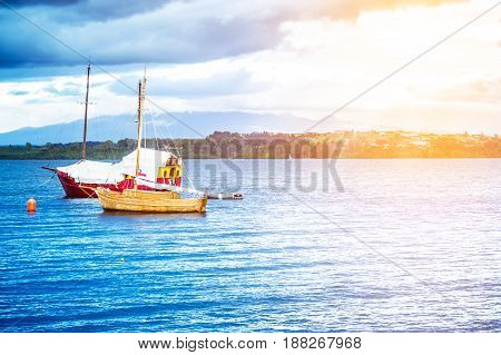 Blue Lake Llanquihue With Boats And Coastline