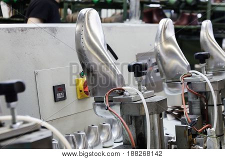 Machines and equipment of the shoe factory, modern footwear production.