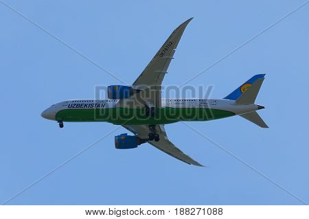 NEW YORK - MAY 20, 2017: Uzbekistan Airways Boeing 787 Dreamliner descends for landing at JFK International Airport in New York
