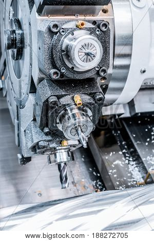 CNC milling machine during operation. Cutting the spiral groove.